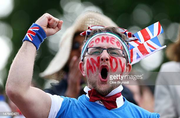 A fan enjoys the atmosphere on Murray Mount on day eleven of the Wimbledon Lawn Tennis Championships at the All England Lawn Tennis and Croquet Club...