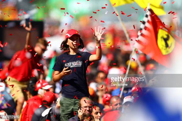 A fan enjoys the atmosphere on track after the Formula One Grand Prix of Italy at Autodromo di Monza on September 3 2017 in Monza Italy