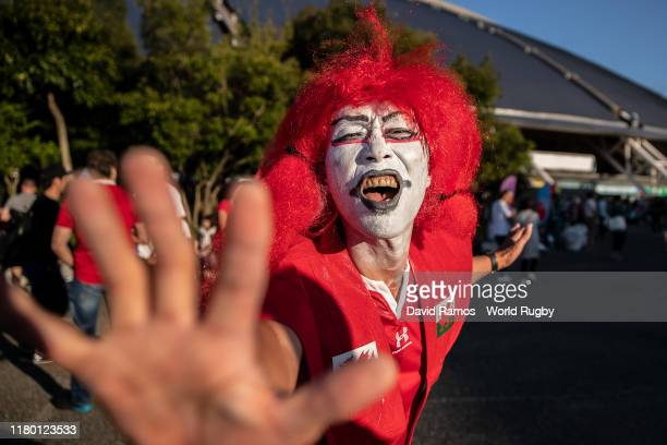 A fan enjoys the atmosphere outside the stadium prior to the Rugby World Cup 2019 Group D game between Wales and Fiji at Oita Stadium on October 09...