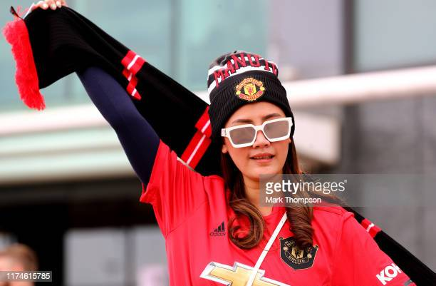 Fan enjoys the atmosphere prior to the Premier League match between Manchester United and Leicester City at Old Trafford on September 14 2019 in...