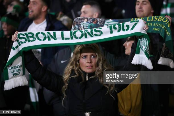 A fan enjoys the pre match atmosphere during the UEFA Europa League Round of 32 First Leg match between Celtic and Valencia at Celtic Park on...