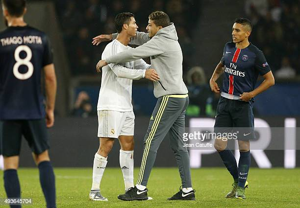 Fan enters the pitch to ask a jersey to Cristiano Ronaldo of Real Madrid during the UEFA Champions League match between Paris Saint-Germain and Real...