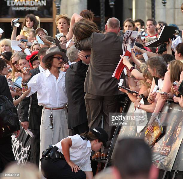 Fan fainting due to extreme heat during 'Pirates Of The Caribbean 2 Dead Man's Chest' London Premiere Outside Arrivals at Odeon Leicester Square in...