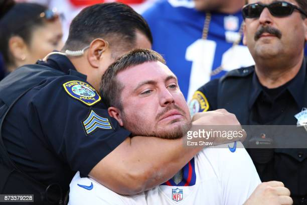 A fan fights with police and is detained during the NFL game between the San Francisco 49ers and the New York Giants at Levi's Stadium on November 12...