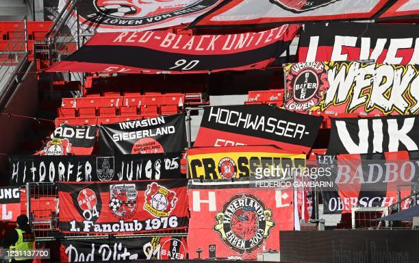 Fan flags are displayed in the empty stands prior to the German first division Bundesliga football match between Bayer 04 Leverkusen and 1 FSV Mainz...