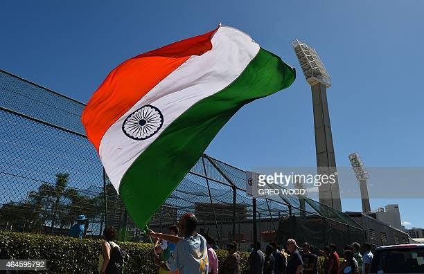 A fan flies a flag as India hold a final training session ahead of their Pool B 2015 Cricket World Cup match against the United Arab Emirates in...