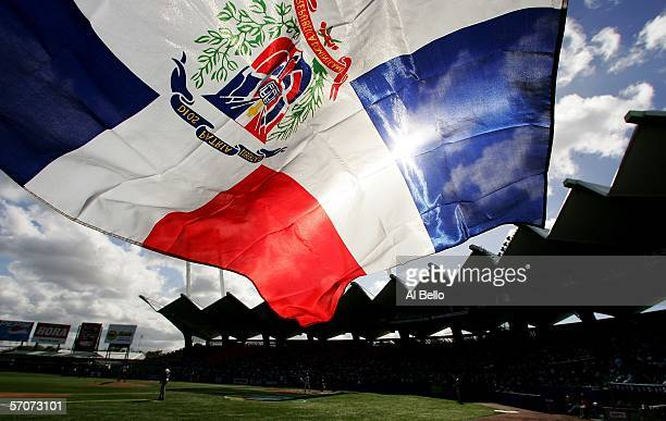A fan flies the Dominican Republic flag during the game against Cuba during Round 2 of the World Baseball Classic on March 13 2006 at Hiram Bithorn...