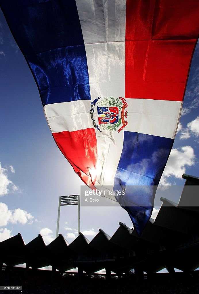 A fan flies the Dominican Republic flag during the game against Cuba during Round 2 of the World Baseball Classic on March 13, 2006 at Hiram Bithorn Stadium in San Juan, Puerto Rico.