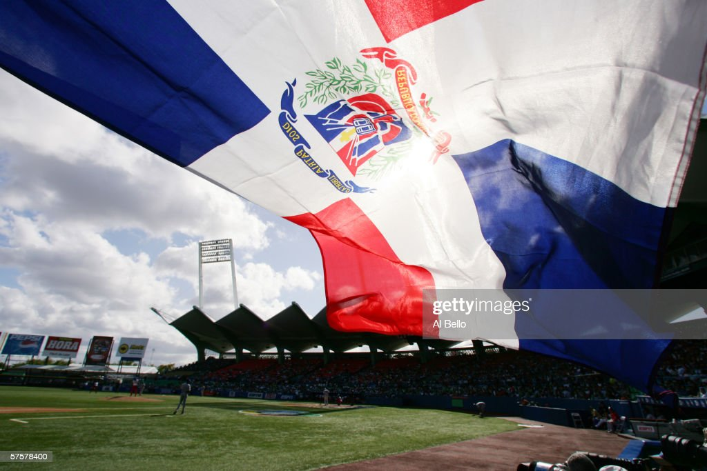 A fan flies the Dominican Republic flag during the game against Cuba during Round 2 of the World Baseball Classic on March 13, 2006 at Hiram Bithorn Stadium in San Juan, Puerto Rico. The Dominican Republic won 7-3.