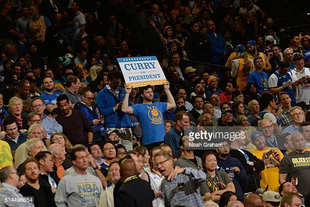 A fan folds up a sign 'Curry For President' during the Oklahoma City Thunder game against the Golden State Warriors on March 3 2016 at ORACLE Arena...