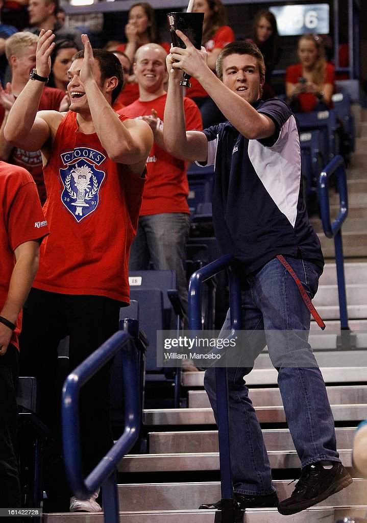 A fan for the Gonzaga Bulldogs plays a cowbell during the game between the Pepperdine Waves and the Gonzaga Bulldogs at McCarthey Athletic Center on February 7, 2013 in Spokane, Washington.
