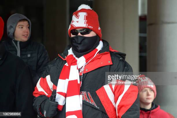 A fan for the Nebraska Cornhuskers prepares for the weather before the game against the Michigan State Spartans at Memorial Stadium on November 17...