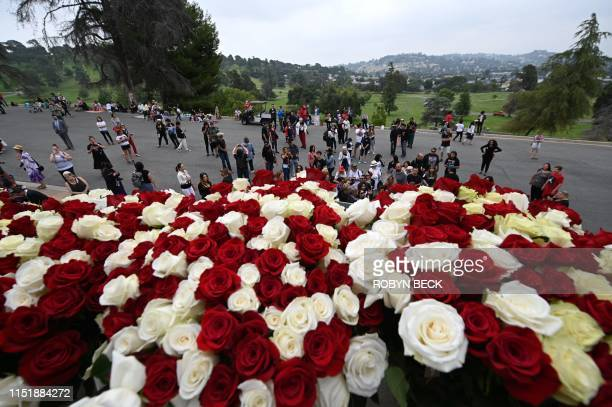 Fan gather outside Michael Jackson's final resting place in the Holly Terrace mausoleum at Forest Lawn Cemetery in Glendale California to remember...