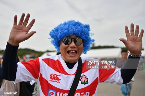 A fan gestures as he awaits the start of the Japan 2019 Rugby World Cup quarterfinal match between Wales and France at the Oita Stadium in Oita on...