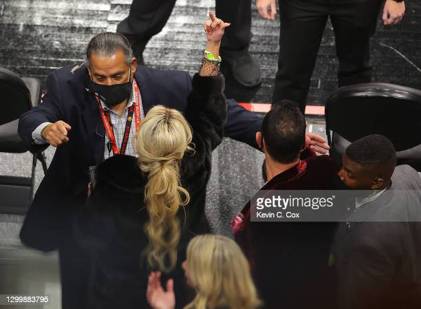Fan gestures as she and her party are escorted out of the arena during the second half of the game between the Los Angeles Lakers and the Atlanta...