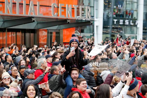 Fan gets a better viewing position atop her boyfriend's shoulders during the Boston Red Sox World Series Victory Parade on October 31, 2018 through...
