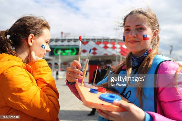 A fan gets their face painted outside the stadium prior to the FIFA Confederations Cup Russia 2017 Group B match between Chile and Australia at...