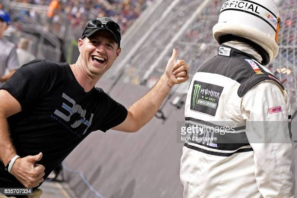 A fan gives a thumbs up to an official during the Bass Pro Shops NRA Night Race on August 19 at the Bristol Motor Speedway in Bristol Tennessee