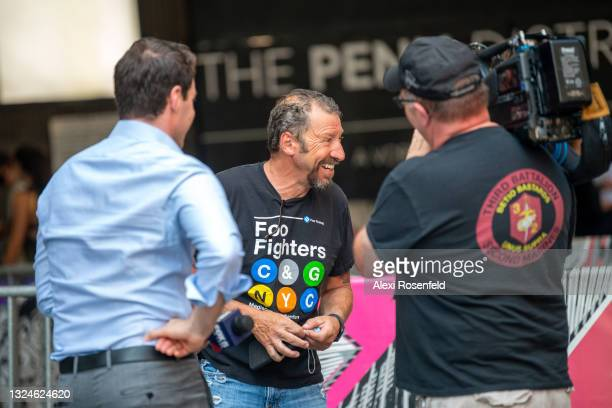 Fan gives an on camera interview ahead of the Foo Fighters concert at Madison Square Garden on June 20, 2021 in New York City. The Foo Fighters...