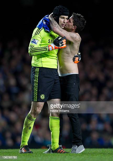A fan gives Petre Cech of Chelsea a kiss during the Premier League match between Chelsea and Aston Villa at Stamford Bridge on December 31 2011 in...
