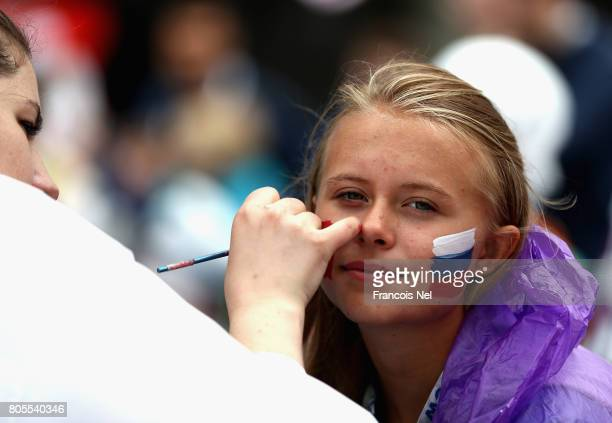 A fan has her face painted prior to the FIFA Confederations Cup Russia 2017 PlayOff for Third Place between Portugal and Mexico at Spartak Stadium on...