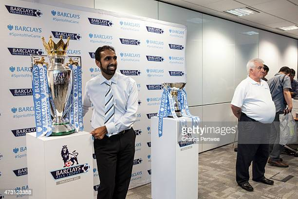 A fan has his photo taken with the Barclays Premier League trophy and the and the Barclays Asia Trophy during a QA at the Barclays office during the...