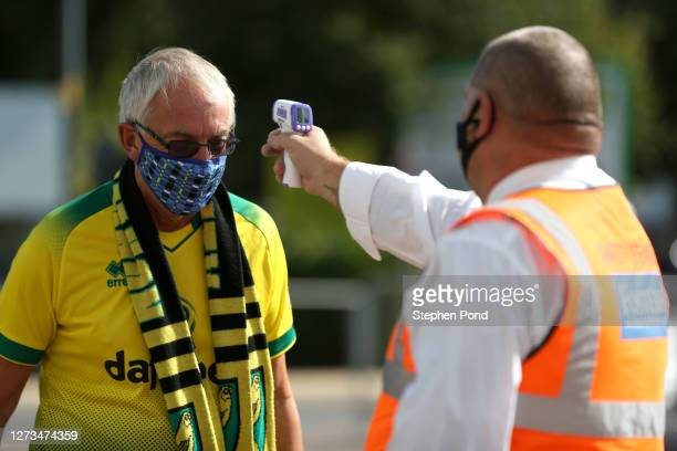 Fan has his temperature checked as he arrives at the stadium during the Sky Bet Championship match between Norwich City and Preston North End at...