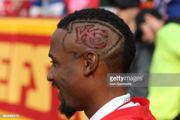 A fan has the Chiefs logo in his hair during a week 12 NFL game between the Buffalo Bills and Kansas City Chiefs on November 26 2017 at Arrowhead...