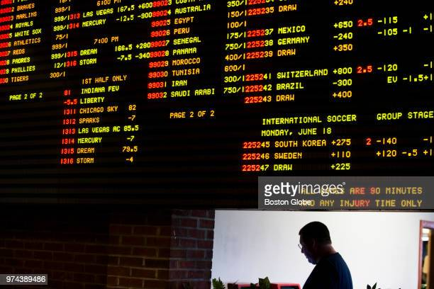 A fan heads into a snack bar under a board displaying odds inside Vegas Sports Betting at Delaware Park Racetrack in Stanton DE on June 10 2018 In...