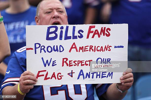 A fan hold up a sign during the national anthem before the game against the San Francisco 49ers and the Buffalo Bills during the first half at New...