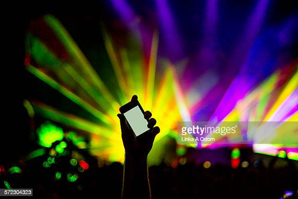 Fan holding cell phone with laser backdrop
