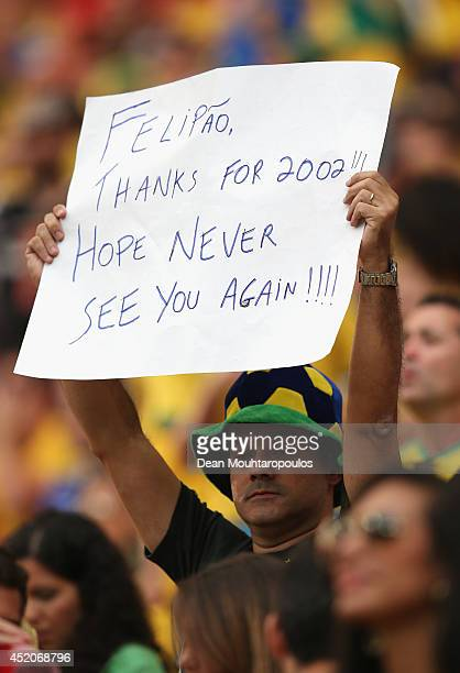 A fan holds a banner prior to the 2014 FIFA World Cup Brazil Third Place Playoff match between Brazil and the Netherlands at Estadio Nacional on July...