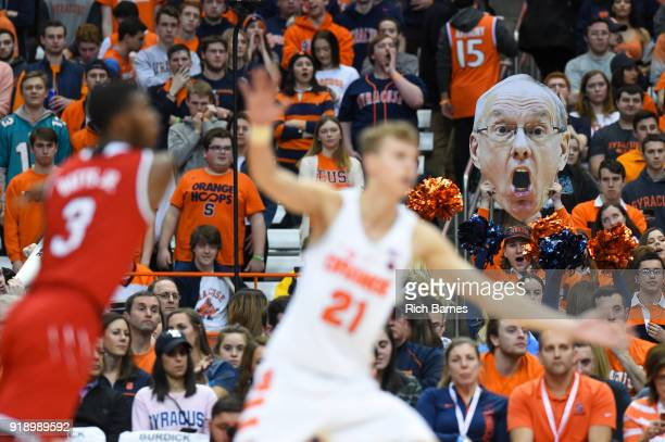 A fan holds a cutout poster of head coach Jim Boeheim of the Syracuse Orange against the North Carolina State Wolfpack during the first half at the...