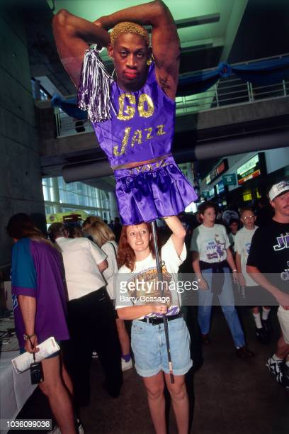 Fan holds a Dennis Rodman of Chicago Bulls during the game against the Utah Jazz on June 6 1997 at the Delta Center in Salt Lake City UT NOTE TO USER...