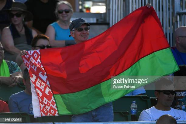 Fan holds a flag of Belarus during the singles final between Saisai Zheng of China and Aryna Sabalenka of Belarus in the Mubadala Silicon Valley...