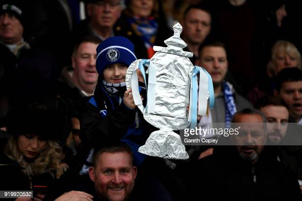 A fan holds a home made FA cup during The Emirates FA Cup Fifth Round match between Rochdale and Tottenham Hotspur on February 18 2018 in Rochdale...