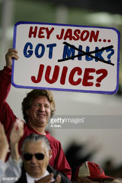 A fan holds a Jason Giambi steroid sign during the game between the New York Yankees and the Boston Red Sox on March 7 2005 at City of Palms Park in...