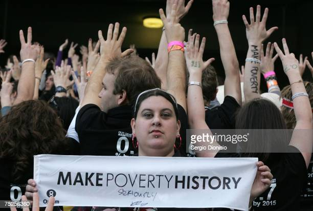 A fan holds a Make Poverty History sign at the Australian leg of the Live Earth series of concerts at Aussie Stadium Moore Park on July 7 2007 in...