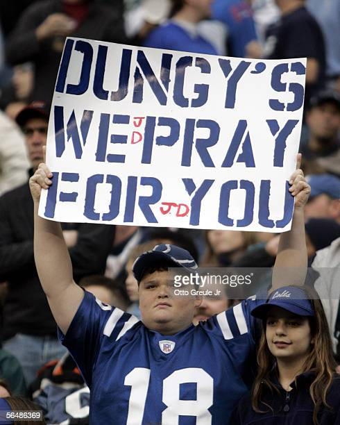 Fan holds a message of support to the family of head coach Tony Dungy of the Indianapolis Colts during the first half of the game against the Seattle...