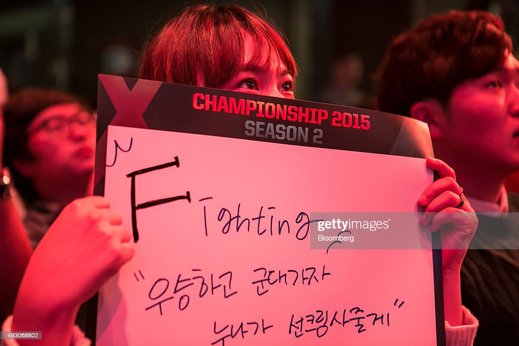 A fan holds a placard as she and other fans watch the final round of the Electronic Arts Inc. (EA) Sports FIFA Online Championship at the Nexon Co. e-Sports Stadium in Seoul, South Korea, on Saturday, Oct. 17, 2015. Video game competitions, known as eSports, have been expanding as gamers seek to shift perceptions around their craft from a basement hobby to a serious money making industry. Photographer: Jean Chung/Bloomberg via Getty Images