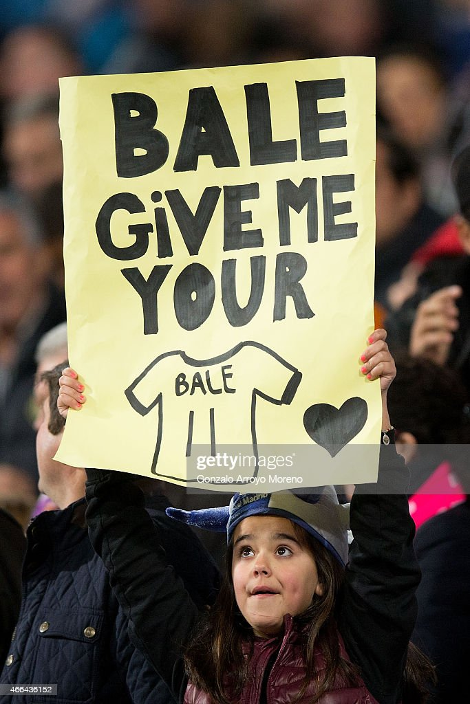 A fan holds a poster up asking for Gareth Bale's t-shirt prior to the start of the La Liga match between Real Madrid CF and Levante UD at Estadio Santiago Bernabeu on March 15, 2015 in Madrid, Spain.