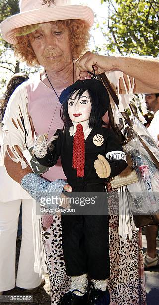 A fan holds a puppet of Michael Jackson outside the gates Michael Jackson's Neverland Ranch in Los Olivos California after Jackson was acquitted on...
