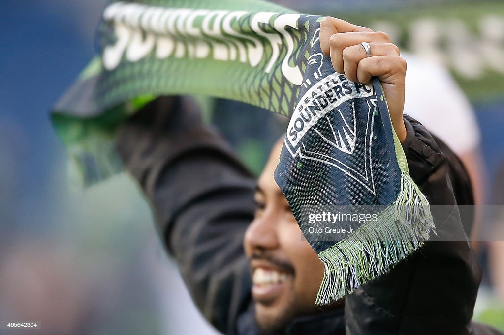 A fan holds a scarf during opening ceremonies prior to the match between the Seattle Sounders FC against the New England Revolution at CenturyLink Field on March 8, 2015 in Seattle, Washington. The Sounders defeated the Revolution 3-0.