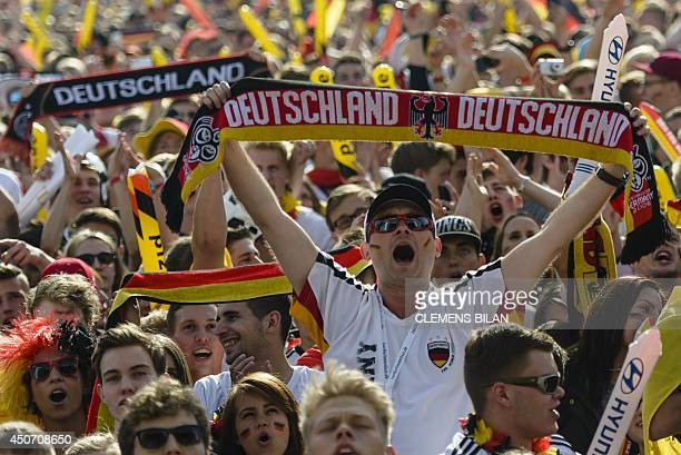 A fan holds a scarf in support of the German national football team near the Brandenburg Gate in Berlin on June 16 2014 during the public viewing of...