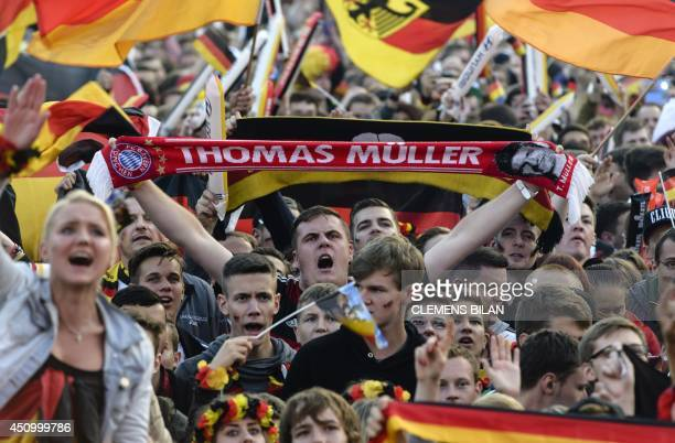 A fan holds a scarf in support of the German national football team near the Brandenburg Gate in Berlin Germany on June 21 2014 during the public...