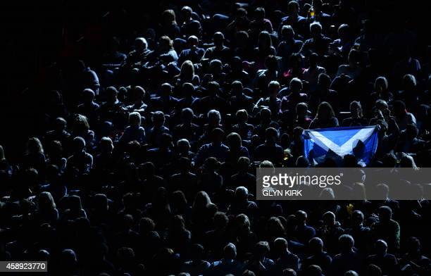 Fan holds a Scottish flag during Group B singles match between Switzerland's Roger Federer and Britain's Andy Murray on day five of the ATP World...