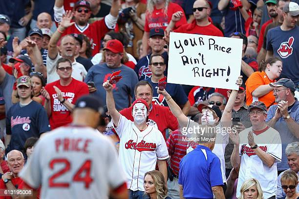 A fan holds a sign as David Price of the Boston Red Sox is relieved in the fourth inning against the Cleveland Indians during game two of the...