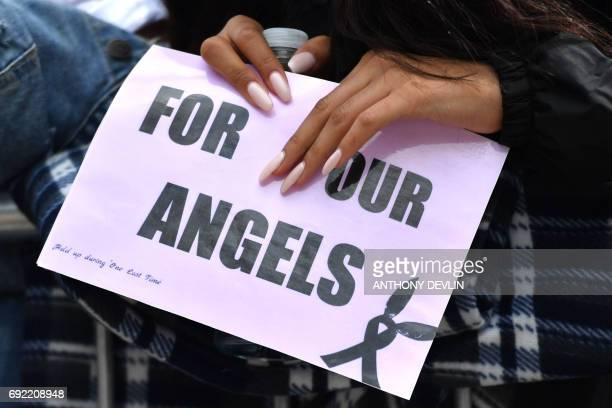 A fan holds a sign as music fans arrive at the Old Trafford Cricket Ground ahead of the One Love Manchester tribute concert in Manchester on June 4...