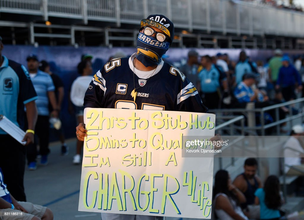 A fan holds a sign as the Los Angeles Chargers make their StubHub Center debut against Seattle Seahawks August 13, 2017, in Carson, California.