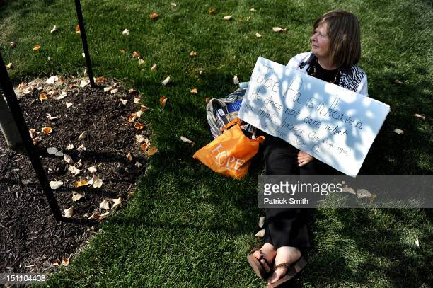 A fan holds a sign at the former site of the Joe Paterno statue prior to the Penn State playing the Ohio Bobcats at Beaver Stadium on September 1...